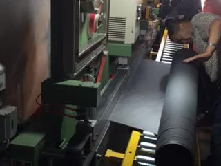 Abrasive belt skiving, gluing and taping machine