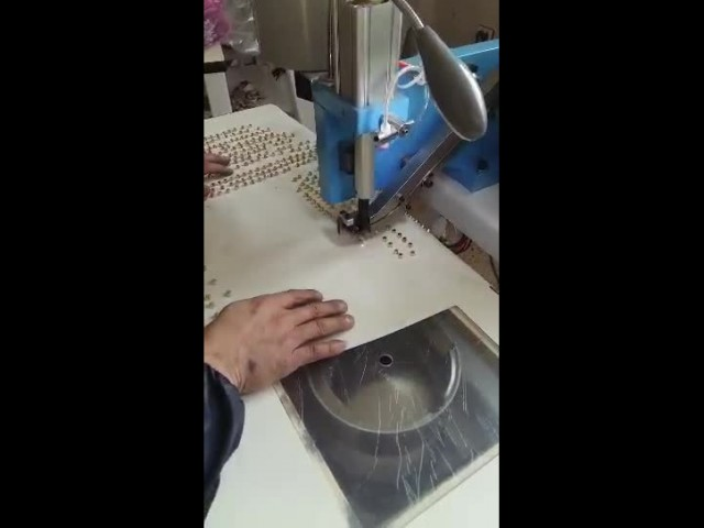 Automatic Pearl and Nail Attaching Machine thumbnail image