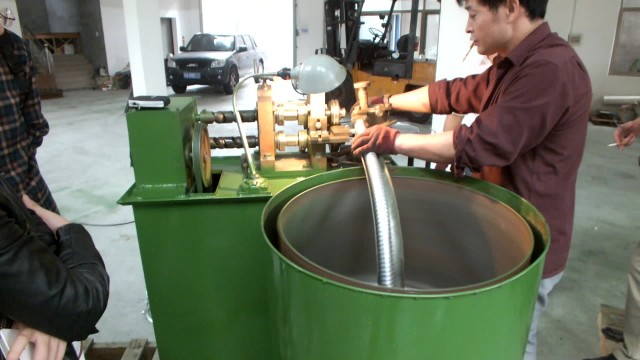 Square-lock flexible metal conduit making machine thumbnail image