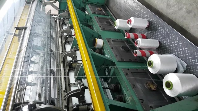 Textile machine,blanket warp knitting machine